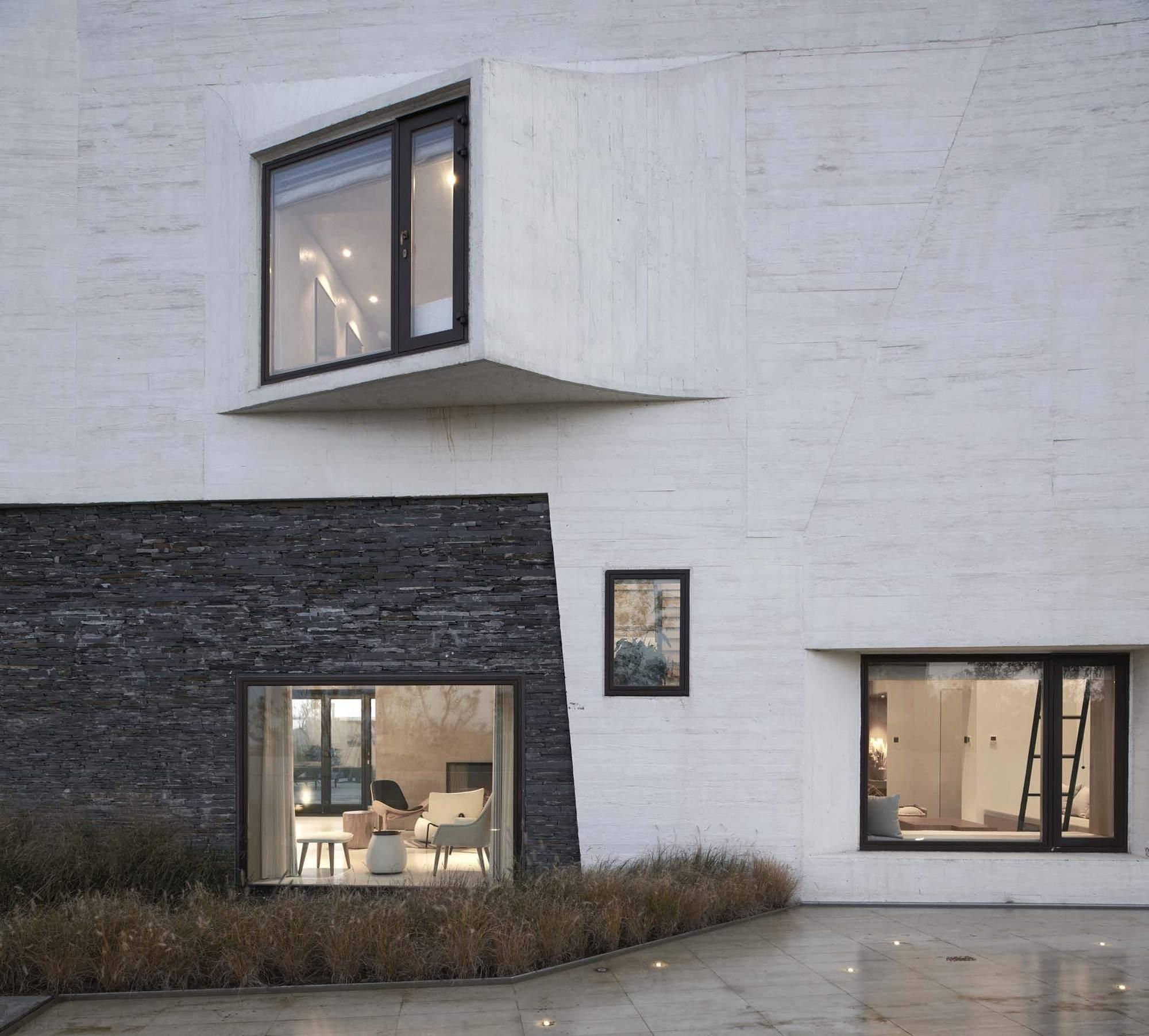 Вилла с волнистым бетонным фасадом, Китай
