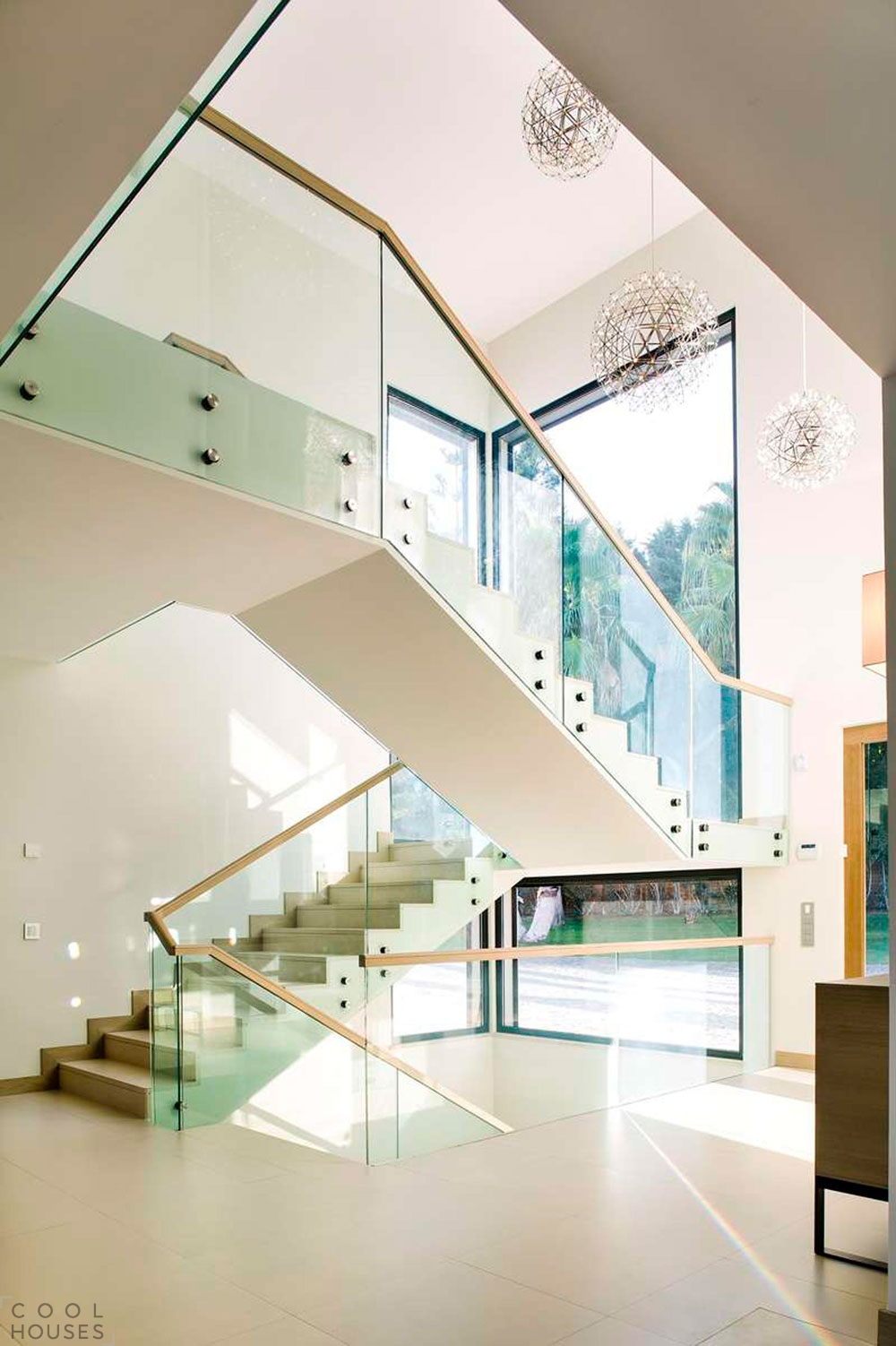 Трехэтажный частный дом от студии Staffan Tollgard Design Group